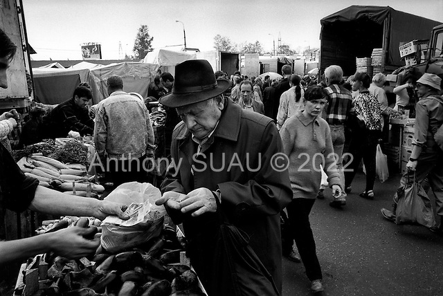 Moscow, Russia  .1998.Checking his hand full of rubles to purchase food for the winter this pensioner is like many in Russian struggling to get by. The Russian government currently owes pensioners more than 20 billion rubles in back pay..