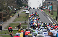 lingering peloton with attacking riders trying to break free<br /> <br /> 69th Kuurne-Brussel-Kuurne 2017 (1.HC)
