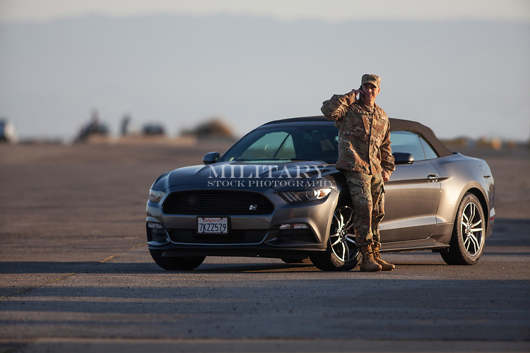 Off dury US Army or Air Force soldier, happy car ownership