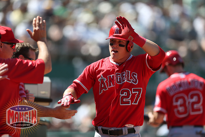 OAKLAND, CA - MAY 1:  Mike Trout #27 of the Los Angeles Angels celebrates with his teammates after scoring a run during the game against the Oakland Athletics at O.co Coliseum on May 1, 2013 in Oakland, California. Photo by Brad Mangin