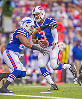 21 September 2014: Buffalo Bills quarterback EJ Manuel hands off to running back Fred Jackson against the San Diego Chargers in the first quarter at Ralph Wilson Stadium in Orchard Park, NY. The Chargers defeated the Bills 22-10 in AFC play. Mandatory Credit: Ed Wolfstein Photo *** RAW (NEF) Image File Available ***