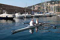 A couple, man and woman, caucasian, rowing in Villefranche sur Mer harbour, oaring, Mediterranean Sea, South of France