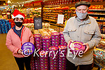Donie Lyons enjoying Quailty sweets and Kathleen McGrath who is enjoying the Heroes sweets in Garveys Listowel on Tuesday.