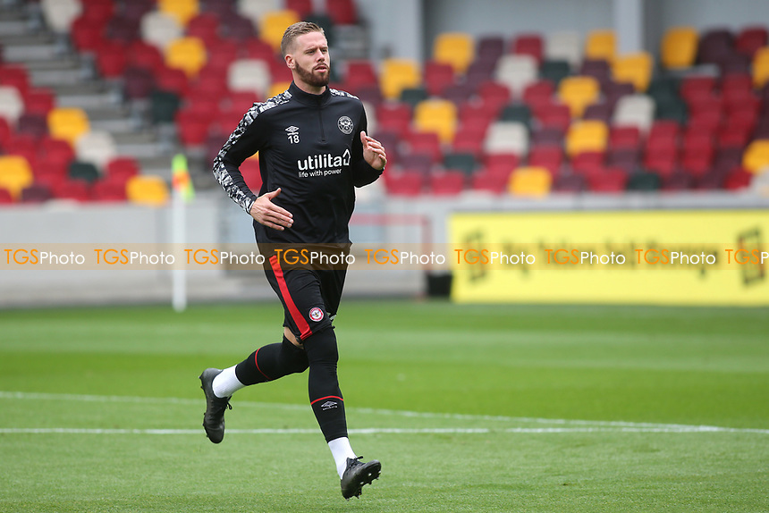 Pontus Jansson of Brentford warms up ahead of kick-off during Brentford vs Coventry City, Sky Bet EFL Championship Football at the Brentford Community Stadium on 17th October 2020