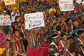Indigenous people wave banners in protest against PEC 215, a proposal to amend the Brazilian constitution to water down indigenous rights during the International Indigenous Games in Brazil. 28th October 2015