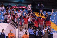 SAN PEDRO SULA, HONDURAS - SEPTEMBER 8: American fans cheer before a game between Honduras and USMNT at Estadio Olímpico Metropolitano on September 8, 2021 in San Pedro Sula, Honduras.