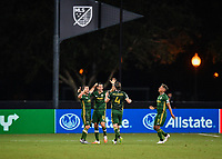 LAKE BUENA VISTA, FL - JULY 18: Diego Valeri #8 of the Portland Timbers celebrates his goal as teammates Sebastián Blanco #10, Jorge Villafaña #4 and Andy Polo #7 join during a game between Houston Dynamo and Portland Timbers at ESPN Wide World of Sports on July 18, 2020 in Lake Buena Vista, Florida.