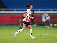 YOKOHAMA, JAPAN - JULY 30: Christen Press #11 of the USWNT celebrates converting a penalty kick during a game between Netherlands and USWNT at International Stadium Yokohama on July 30, 2021 in Yokohama, Japan.