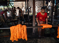 Production and dyeing of Silk and Cotton in Mandalay the traditional way. Myanmar