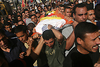 "Palestinian mourners carry the body of Mohammed Abu Herbet, 23, during his funeral in the town of Beit Hanoun, northern Gaza Strip, Sunday, Nov. 4, 2007. Israeli aircraft fired at a rocket-launching site in the northern Gaza Strip early Sunday, killing three civilians, including Abu Herbet, sleeping in a nearby storage container, Palestinian officials said. The Israeli military said the air strike targeted a rocket squad that attacked southern Israel earlier in the morning. ""phto by Fady Adwan"""