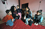 Sladjana Nedeljkovic (second from left), a Roma teacher at the Nasa Radost preschool in Smederevo, Serbia, visits with Elizabeth Delmako and her children in the family's home in Krivac, one of the largest Roma settlements in the region. Delmako's children have missed several days of school during an unusual cold spell because they didn't have appropriate shoes to walk through the snow. The eight-member family lives in a one-room house. The school's work is supported by Church World Service.