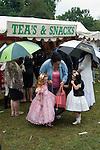 Barnet Gypsy Horse Fair Hertfordshire UK. Children girls dressed in best cloths with grandmother. September annually for over 800 years.