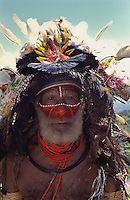 Huli Wigmen from the Tari Valley in the Southern Highlands of Papua New Guinea at a Sing-sing Mt Hagen Papua New Guinea. Wearing bird of paradise feathers and plumes