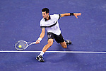 SHANGHAI, CHINA - OCTOBER 14:  Novak Djokovic of Serbia returns a ball to Richard Gasquet of France during day four of the 2010 Shanghai Rolex Masters at the Shanghai Qi Zhong Tennis Center on October 14, 2010 in Shanghai, China.  (Photo by Victor Fraile/The Power of Sport Images) *** Local Caption *** Novak Djokovic