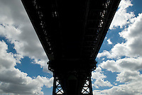 Upward View of the Manhattan Bridge, looking up toward cloudy sky