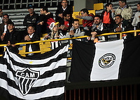 BOGOTA- COLOMBIA – 18-03-2015: Hinchas de Atletico Mineiro de Brasil, animan a su equipo durante partido entre Independiente Santa Fe de Colombia y Atletico Mineiro de Brasil, por la segunda fase, grupo 1, de la Copa Bridgestone Libertadores en el estadio Nemesio Camacho El Campin, de la ciudad de Bogota.  / Fans of Atletico Mineiro of Brasil, cheer for their team during a match between Independiente Santa Fe of Colombia and Atletico Mineiro of Brasil for the second phase, group 1, of the Copa Bridgestone Libertadores in the Nemesio Camacho El Campin in Bogota city. Photo: VizzorImage / Luis Ramirez / Staff.