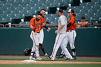 Bowie Baysox Ryan McKenna (left) celebrates with teammates - including (L-R) Zach Jarrett, Stuart Levy, and Willy Yahn - after laying down a game winning squeeze play bunt during an Eastern League game against the Binghamton Rumble Ponies on August 21, 2019 at Prince George's Stadium in Bowie, Maryland.  Bowie defeated Binghamton 7-6 in ten innings.  (Mike Janes/Four Seam Images)
