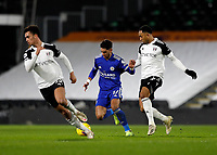 3rd February 2021; Craven Cottage, London, England; English Premier League Football, Fulham versus Leicester City; Kenny Tete of Fulham challenges Ayoze Perez of Leicester City