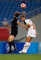 USWNT defender (3) Christie Rampone up for a header with New Zealand forward (9) Amber Hearn while playing at Wulihe Stadium. The USWNT defeated New Zealand, 4-0, during the 2008 Beijing Olympics in Shenyang, China.  With the win, the USWNT won group G and advanced to the semifinals.