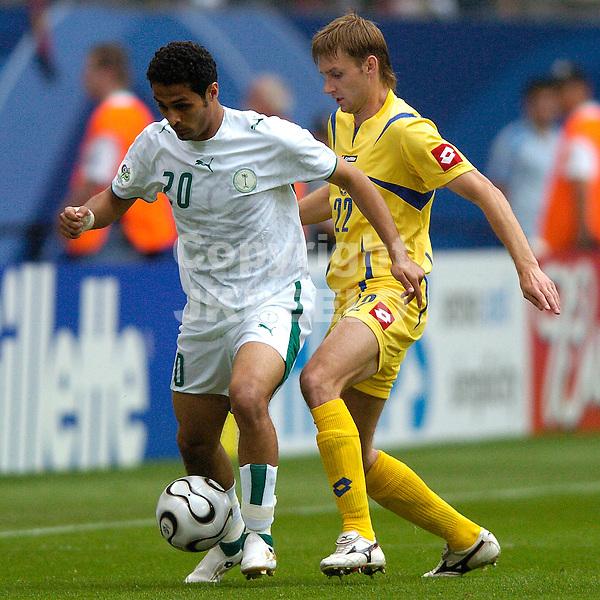 hamburg, 19-06-2006, saudi arabie - oekraine alkahtani in duel met sviderskyi