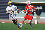 Baltimore, MD - March 3: Midfielder Colin McLinden #4 of the Fairfield Stags moves the ball to the cage against  Midfielder Will Fejes #23 of the UMBC Retrievers during the Fairfield v UMBC mens lacrosse game at UMBC Stadium on March 3, 2012 in Baltimore, MD.