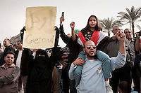 Protesters in Tahrir Square. Continued anti-government protests take place in Cairo calling for President Mubarak to stand down. After dissolving the government, Mubarak still refuses to step down from power. .