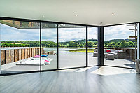 BNPS.co.uk (01202 558833)<br /> Pic: ShorePartnership/BNPS<br /> <br /> Pictured: The view from inside.<br /> <br /> A brand new waterfront home perfect for paddleboarders is on the market for £1.3m.<br /> <br /> Creek View is built on a former boatyard and has direct water access to Restronguet Creek from steps in the back garden.<br /> <br /> The contemporary four-bedroom house has an open-plan living space and floor-to-ceiling glass overlooking the water to make the most of its stunning location.