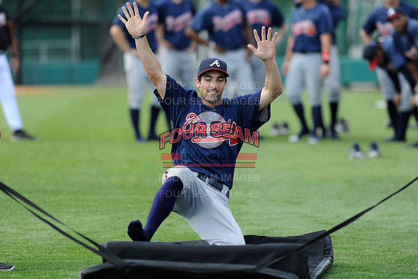 Outfielder Keith Curcio (27) of the Atlanta Braves farm system in a Minor League Spring Training sliding drill on Monday, March 16, 2015, at the ESPN Wide World of Sports Complex in Lake Buena Vista, Florida. (Tom Priddy/Four Seam Images)