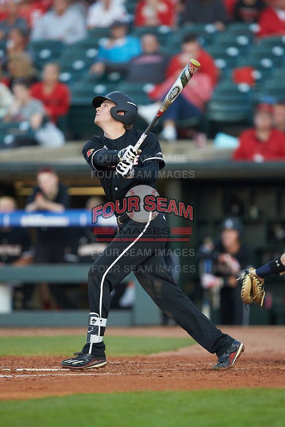 Devin Mann (7) of the Louisville Cardinals follows through on his swing against the Notre Dame Fighting Irish in Game Eight of the 2017 ACC Baseball Championship at Louisville Slugger Field on May 25, 2017 in Louisville, Kentucky. The Cardinals defeated the Fighting Irish 10-3. (Brian Westerholt/Four Seam Images)