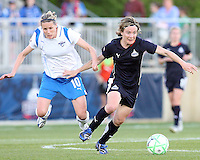 Sonia Bompastor #8 of the Washington Freedom pushes away from Kelly Smith #10 of the Boston Breakers during a WPS match at the Maryland Soccerplex, in Boyd's, Maryland, on April 18 2009. Breakers won the match 3-1.