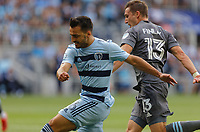 ST. PAUL, MN - AUGUST 21: Ilie Sanchez #6 of Sporting Kansas City and Ethan Finlay #13 of Minnesota United FC battle during a game between Sporting Kansas City and Minnesota United FC at Allianz Field on August 21, 2021 in St. Paul, Minnesota.