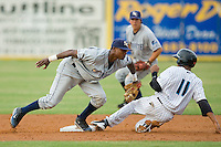 Shortstop Tim Beckham #22 of the Charlotte Stone Crabs applies a late tag as Miguel Fermin #11 of the Jupiter Hammerheads steals second base at Roger Dean Stadium June 15, 2010, in Jupiter, Florida.  Photo by Brian Westerholt /  Seam Images