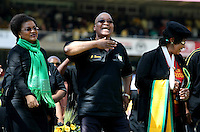 Baleka Mbete, Jacob Zuma and Winnie Madikizela Mandela dance at the African National Congress (ANC) party's final Siyanqoba (victory) rally held at the Ellis Park Stadium in Johannesburg before the 2009 general election.