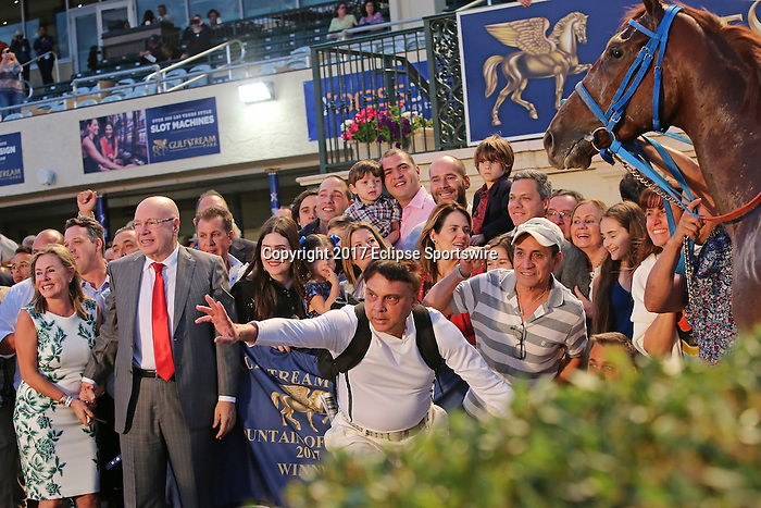 HALLANDALE BEACH, FL - MARCH 04:  Gunnevera's connections with owner, Salomon Del Valle, have fun in the winners circle  after winning the $400,000 Xpressbet Fountain Of Youth Stakes (Grade II) at Gulfstream Park on March 04, 2017 in Hallandale Beach, Florida. (Photo by Liz Lamont/Eclipse Sportswire/Getty Images)