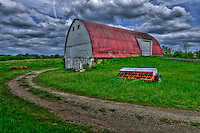 Ready for planting. Bright sun and clouds travel across the barn on Cleveland, Ave. The nearby fields are used for corn, soybeans and hay plantings.  Photo is copyright Gary Gardiner who owns all usage rights to the image.