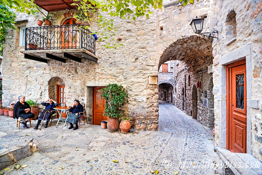 Old women outside traditional house in the medieval mastic village of Mesta on the island of Chios, Greece