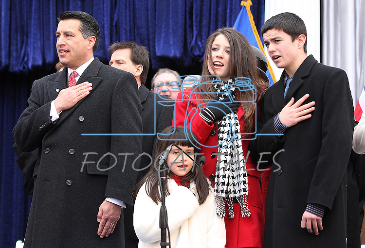 Nevada Gov. Brian Sandoval says the Pledge of Allegiance, which was led by his children Marisa, 6, Maddy, 14 and James, 15, during Monday's inauguration, Jan. 3, 2011 at the Capitol in Carson City, Nev. <br /> Photo by Cathleen Allison