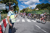 peloton rolling through town<br /> <br /> Stage 12 from Chauvigny to Sarran (218km)<br /> <br /> 107th Tour de France 2020 (2.UWT)<br /> (the 'postponed edition' held in september)<br /> <br /> ©kramon