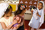 preschool Headstart 3-4 year olds group of three girls pretend play with dolls talking and discussing game