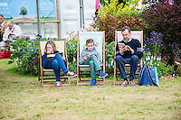 Hay on Wye, UK. Wednesday 01 June 2016<br /> Pictured:  A Family sit and read books at the festival <br /> Re: The 2016 Hay festival take place at Hay on Wye, Powys, Wales