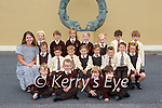 Ms Sarah Cahill with her Junior Infants in Lissivigeen NS on Wednesday (names to follow)