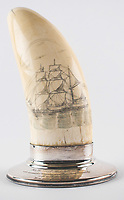 BNPS.co.uk (01202 558833)<br /> Pic: RR Auction/BNPS<br /> <br /> A prized scrimshaw whale tooth which JFK displayed on his desk at the Oval Office has emerged for sale for £22,000. ($30,000)<br /> <br /> The 6.5ins rarity depicts a bark-rigged Yankee whaler boat with sails scanning the horizon for spouting whales.<br /> <br /> President John Kennedy was a passionate scrimshaw collector and this example took pride of place in the White House until his assassination in 1963.<br /> <br /> A year later, his widow Jackie Kennedy gave it to an admired US general as a token of appreciation for his 'devotion to country and President Kennedy'.<br /> <br /> The sperm whale tooth, which is 4.25ins in diameter, is being offered for sale for the first time with RR Auction, of Boston, US.