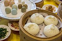 Yangzhou, Jiangsu, China.  Breakfast at Ye Chun Tea House.  Dim Sum, Buns, Dumplings.  Pigeon, Quail, and Chicken Eggs in Background.