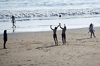 WEATHER PICTURE WALES<br /> A family play on the beach during the unusually warm weather in Langland Bay near Swansea, Wales, UK. Wednesday 27 February 2019