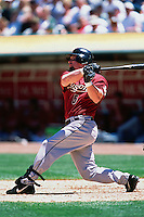 OAKLAND, CA - Jeff Bagwell of the Houston Astros bats against the Oakland Athletics during a game at the Oakland Coliseum in Oakland, California in 2002. Photo by Brad Mangin
