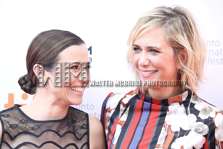 Linda Cardellini and Kristen Wiig attend the 'Welcome To Me' premiere during the 2014 Toronto International Film Festival at Princess of Wales Theatre on September 5, 2014 in Toronto, Canada.