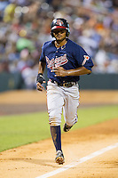 Elmer Reyes (2) of the Gwinnett Braves jogs down the third base line on his way to scoring a run against the Charlotte Knights at BB&T Ballpark on August 19, 2014 in Charlotte, North Carolina.  The Braves defeated the Knights 10-5.   (Brian Westerholt/Four Seam Images)