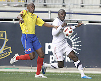 Jozy Altidore #17 of the USA MNT charges past Aquivaldo Mosquera #2 of Colombia during an international friendly match at PPL Park, on October 12 2010 in Chester, PA. The game ended in a 0-0 tie.