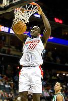 Charlotte Bobcats Emeka Okafor dunks the ball over the Dallas Mavericks during an NBA basketball game Time Warner Cable Arena in Charlotte, NC.