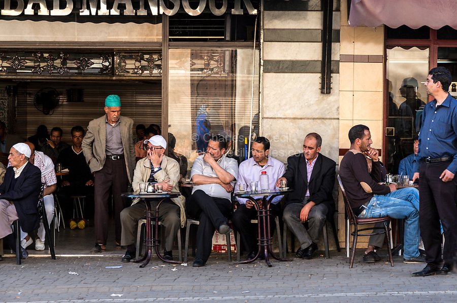 Meknes, Morocco.  Men Relaxing at a Sidewalk Cafe.